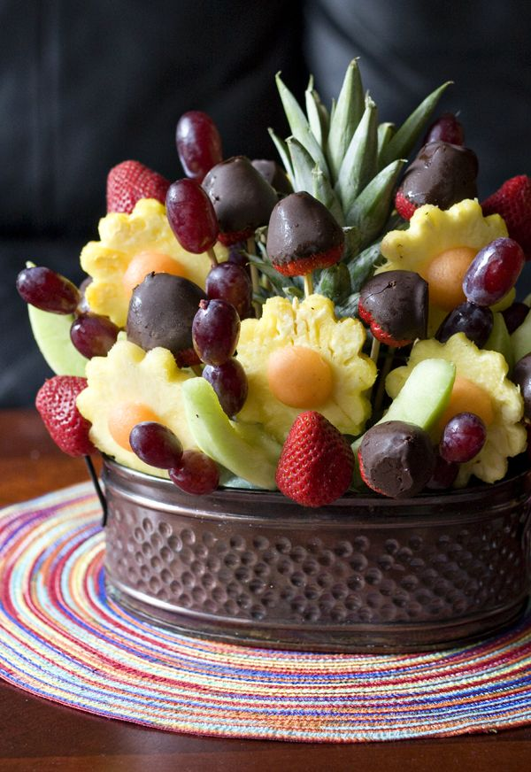 Cut the pinapple flower with a flower cookie cutter the centre are melon balls with one side cut so it sits flat then strawberries dipped in chocolate the leaves are honey dew melon cut in slices. Enjoy!