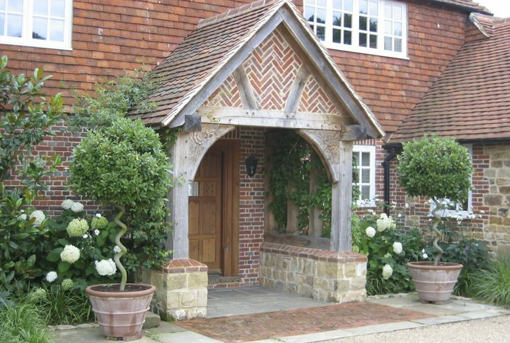 Perfectly placed topiary flanking this beautiful porch.
