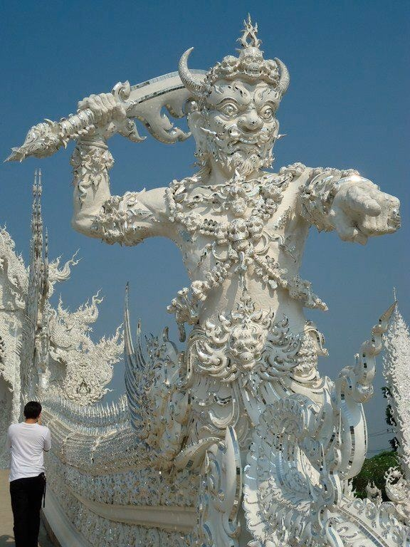 Gard of the white temple Thailand made by Jos Bus