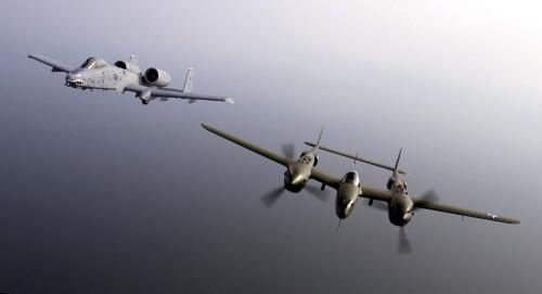 "Lockheed P-38 Lightning: A US Air Force (USAF) A-10 Thunderbolt attack aircraft (left) piloted by Captain (CPT) Matt Kouchoukos flies formation with a vintage P-38 Lightning fighter aircraft named ""Glacier Girl,"" piloted by Steve Hinton was dug out from 268-feet of ice in Eastern Greenland in 1992. Both aircraft are flying in the Heritage Flight which is part of the Airpower over Hampton Roads show at Langley Air Force Base (AFB), Virginia (VA)."