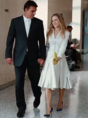 Carrie's real wedding dress is the classically chic number that we see at the end of the film in the courthouse. After all is forgiven, Mr. Big and Carrie march down to city hall and partake in a simple ceremony, in which she is wearing a supposedly nameless dress. It is this dress, or wedding suit, that has been a hot topic of many conversations since Carrie's big wedding. This Christian Dior wedding suit is sophisticated, simple and perfect in every way.