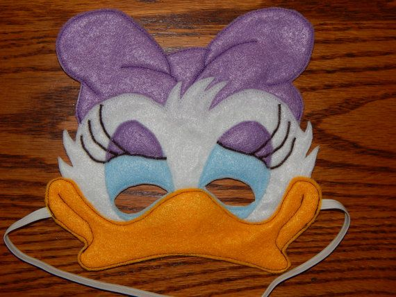 Daisy Duck or Webbigail Felt Mask. This listing is for 1 of the pictured masks. The Eye Shadow and Hair Bow on this mask can be purple or pink.