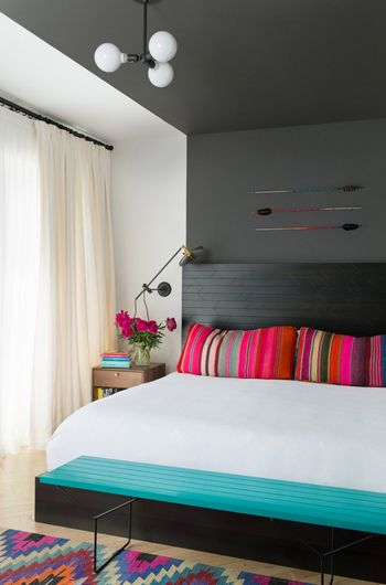 bedroom, charcoal gray accent wall behind headboard, turquoise accents, hot pink accents (Benjamin Moore, Kendall Charcoal):