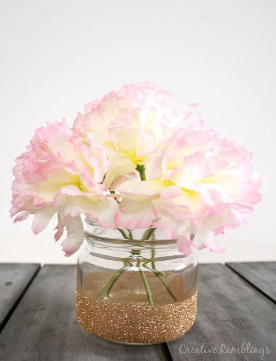 `Easy to make glitter mason jar vase. Such a simple and lovely idea for spring or as a centerpiece for any special event such as a rustic wedding, baby shower or First Communion!