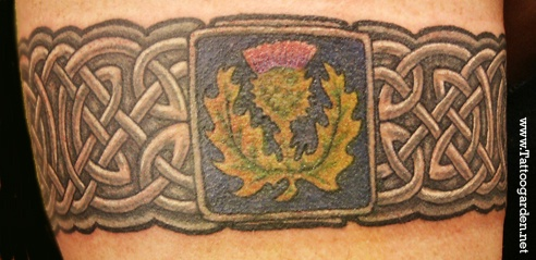 Custom color celtic band tattoo with Thistle