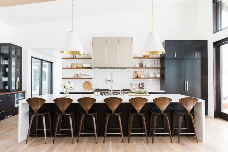 Love the glass sided cabinet on the Left.  Black, white and wood kitchen with brass hardware || Studio McGee