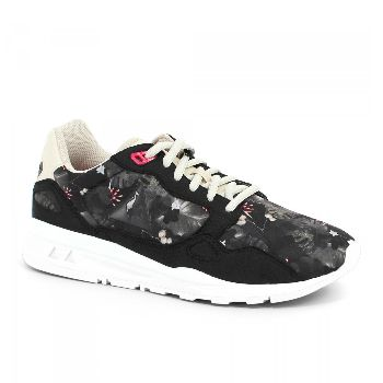 Le Coq Sportif Womens Black & Grey R900 Winter Floral Sneakers: The LCS R900 W Winter Floral, an heir to the iconic LCS R1000, has a modern, athletic silhouette. It is comfortable under any circumstances, thanks to its light weight and Dynactif cushioning and features a winter tropical print and subtle details: imitation suede onlays, a contrast beige tongue, and a pink top eyelet.