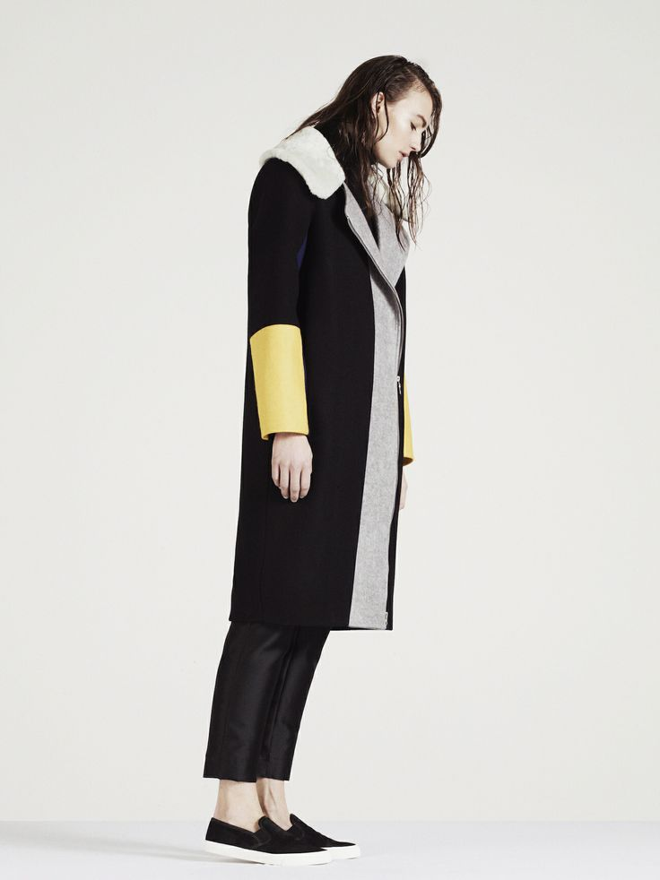 PAPER London AW14 www.paperlondon.com/ Black wool coat with shearling collar and yellow and grey contrast paneling