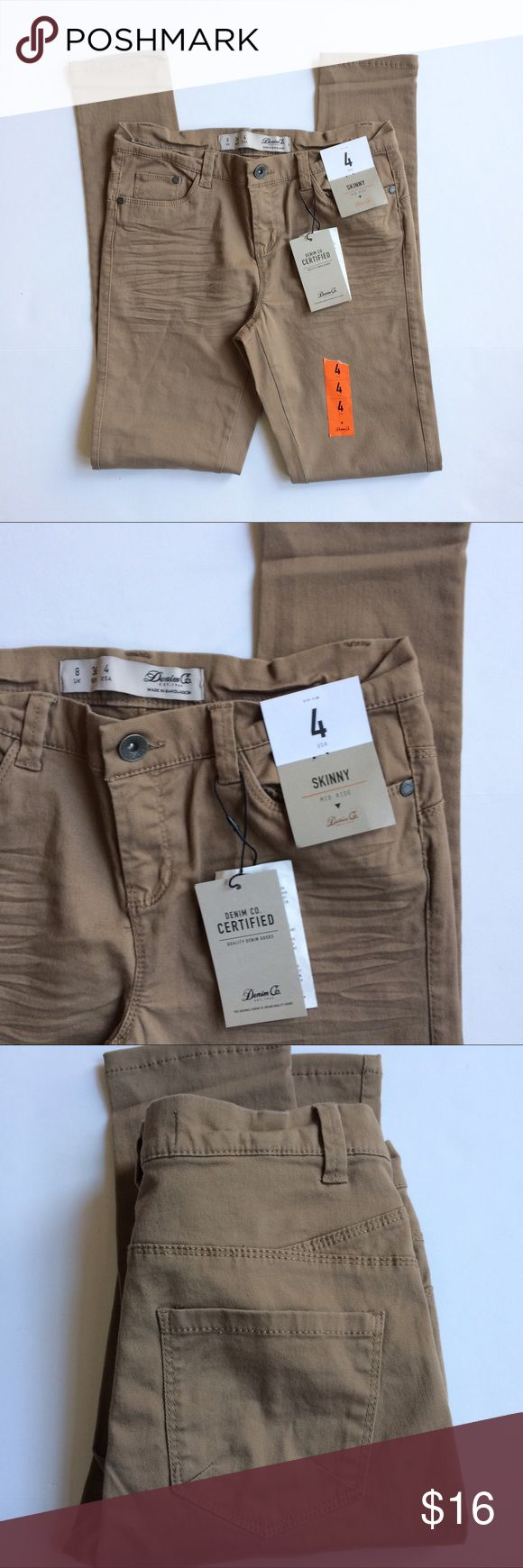 🆕 Skinny Khakis New with tags, skinny khaki pants with very stretchy material. Mid Rise. Waist measures 26 inches, inseam measures 29 inches. Pants Skinny