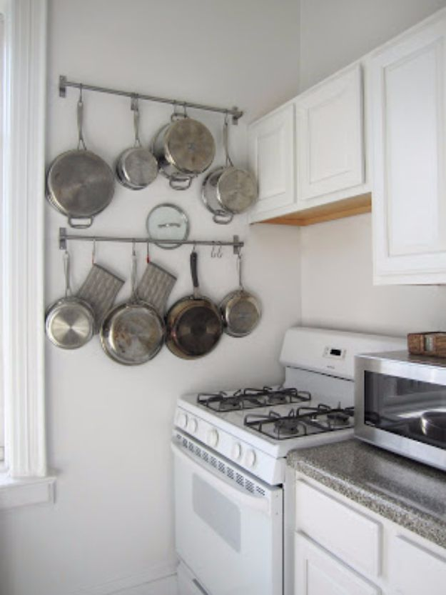 DIY Organizing Ideas for Kitchen - Use Nifty Rails To Hang Pots And Pans - Cheap and Easy Ways to Get Your Kitchen Organized - Dollar Tree Crafts, Space Saving Ideas - Pantry, Spice Rack, Drawers and Shelving - Home Decor Projects for Men and Women http://diyjoy.com/diy-organizing-ideas-kitchen