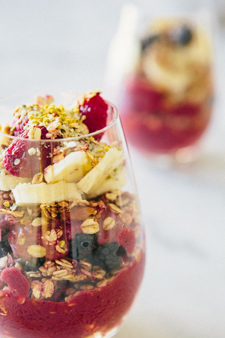 Acacia Berry Parfait 3.5 oz frozen acai 1 banana 1 cup frozen raspberries 1 cup frozen strawberries 1 cup almond milk 1/2-1 cup of raspberry granola fruit of your choosing- I used raspberries, banana, and blackberries hemp seeds and bee pollen to garnish (optional)