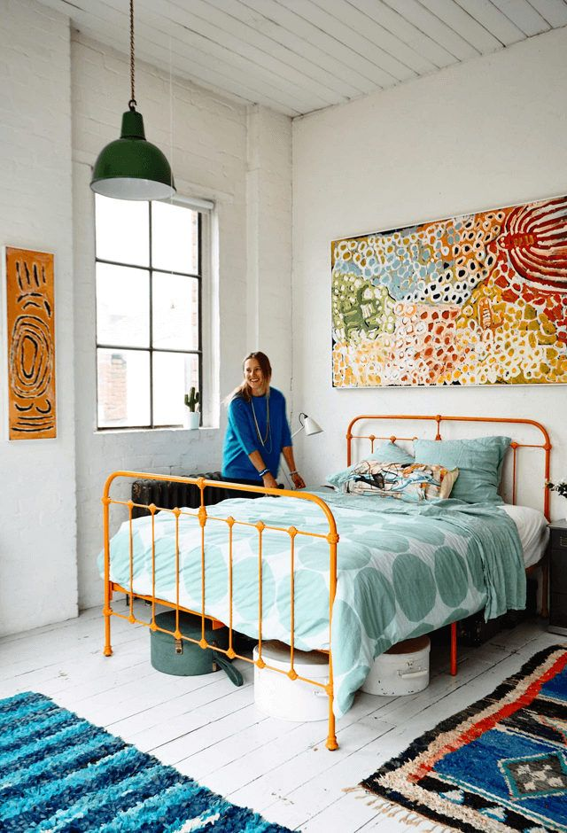 Bright coloured bedroom (orange bedframe) in artist Saskia Folk's Melbourne home in a former factory.  Photo: Derek Swalwell. Stylist: Heather Nette King