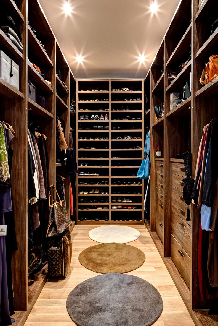 Walk-in closet with shelving to the ceiling.