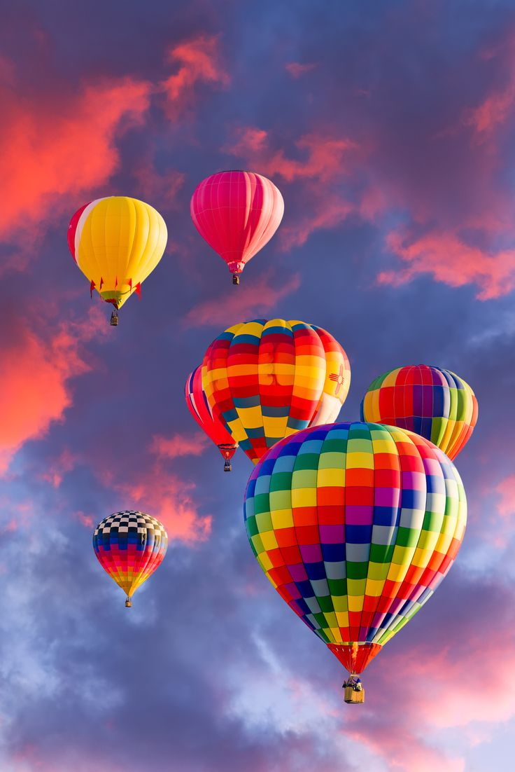 Colorful Hot Air Balloons In Flight Illuminated By Early