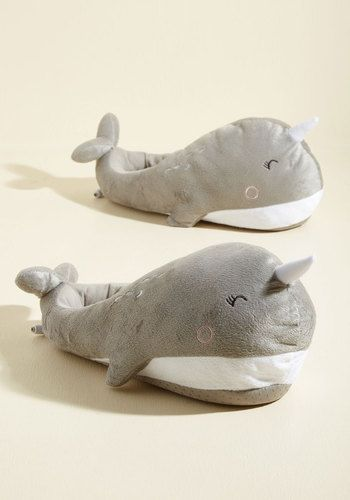 You're always in the mood for cuddling up, especially with these narwhal-shaped foot warmers! Powered by your Mac or PC through an included USB cord to keep your toes toasty and warm, these adorable plush slippers flaunt the smiling, horn-accented face and body of a unicorn of the sea, while gripping dots on the bottom ensure safe, slip-free steps. Cozy and cute get along swimmingly when it comes to this precious pair!