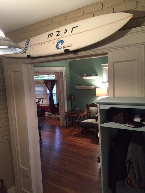 A Surfboard Makes A Great Home Decoration   Hereu0027s Unused Overhead Space  Turned Design Art