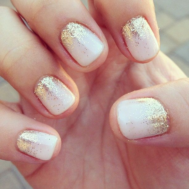 One color colour nail art: white (ivory) and gold glitter (eyeshadow, pigment). Put dust on your skin (above your nail) and blow it on your nail white the white polish is still wet