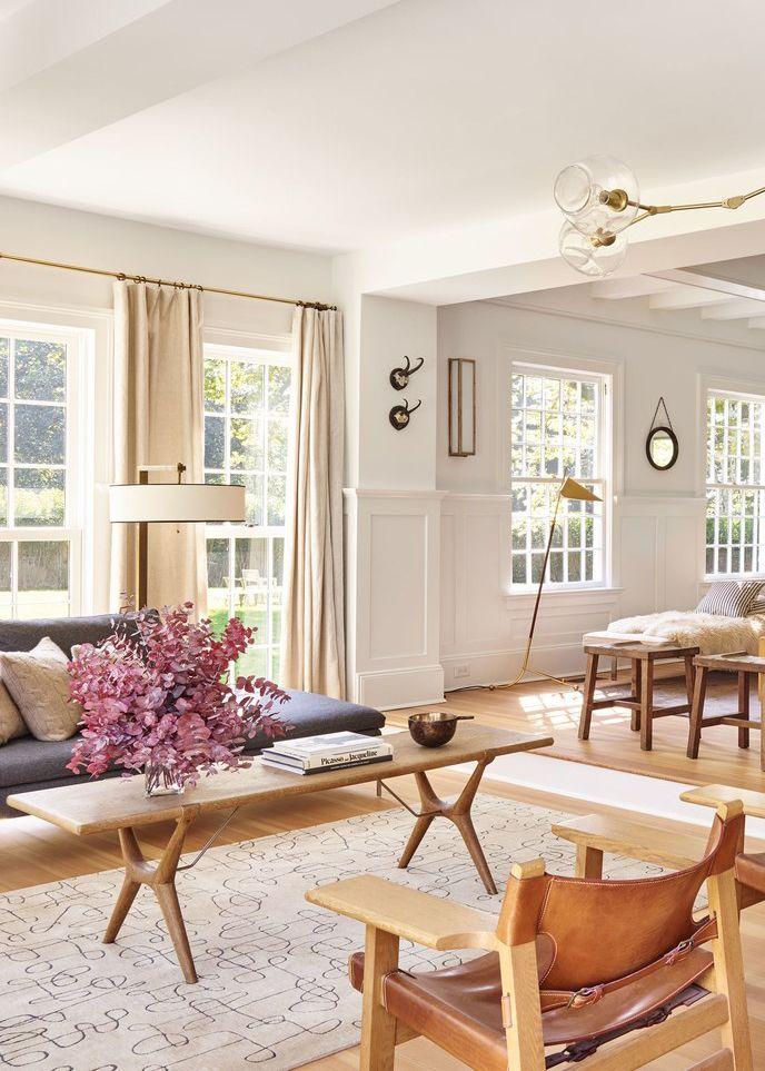 an expansive living room features warm neutrals and tons of light   pilar guzman house tour via coco kelley