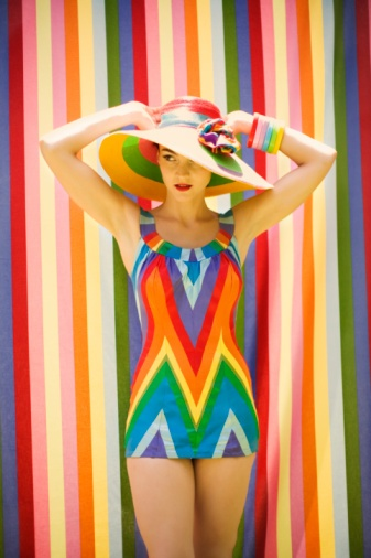 Awesome retro multi color bathing suit- I would totally wear that if it was in my size!