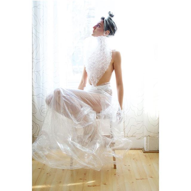 Plastic Dress, series Refashioning Garbage by Sina Basila. Materials: laundry bag, onion netting, packaging bubble wrap, and furniture packaging. #refashioning #trash into wearable items that outlast their discardable nature #RefashioningGarbage #repurpose
