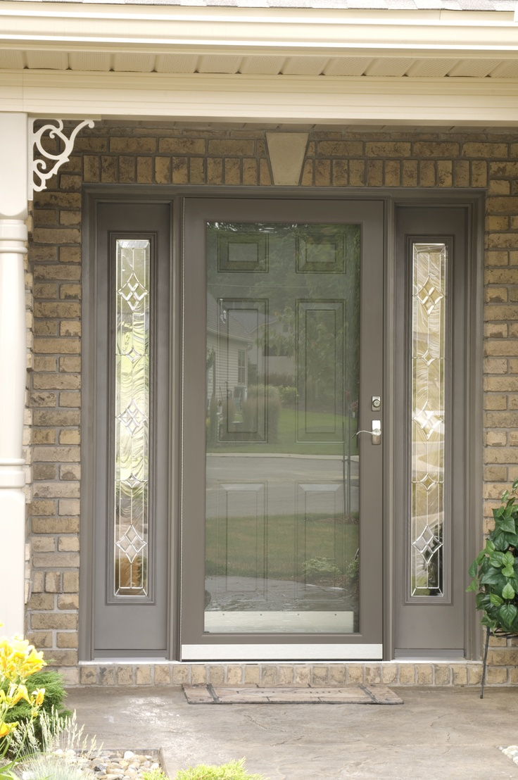 I Think This Storm Door Would Show Off My Front Door Well, Which Is A Oval  Glass Prisim Door. Tan Storm Door And Side Lights With Contrasting Entry  Door.