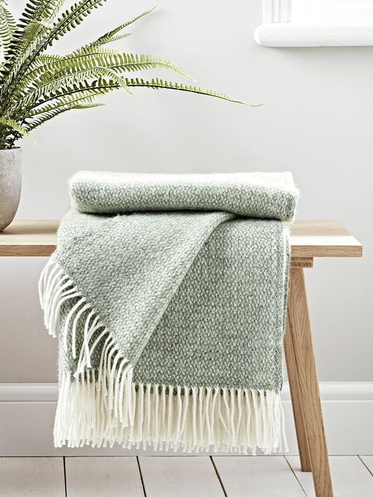Crafted from pure wool in a subtle shade of sage, our Soft Wool Throw is handwoven in the UK. Finished with elegant cream fringing, it drapes beautifully in your home and warms cold shoulders on chilly evenings.