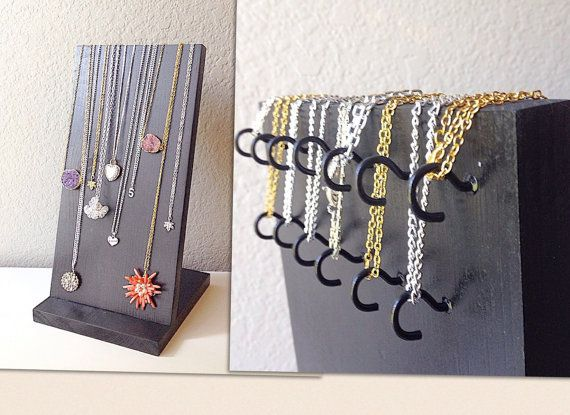 As seen in Bauble Bar displays!  Necklace display - specially designed for long necklaces, up to 28 inches.  Great for retail store, craft fairs, or home display. A Jewelry Designer will love this!  Dimensions: Base is 7.25 wide by 8 deep. Big enough to keep your display sturdy so it wont tip over with even the heaviest of necklaces. Display board is 7.25 wide by 14 tall.  Features 13 hidden hooks to hang your necklaces on. Available in over 30 color choices! Stand is shown in black for…