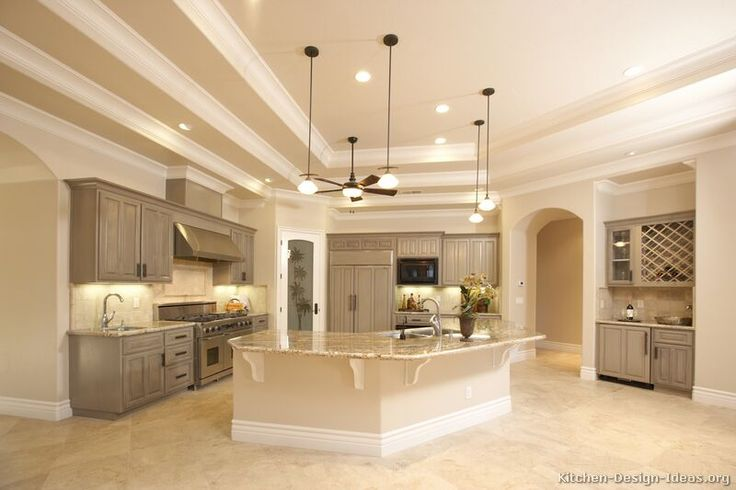 gray stained cabinets with travertine floor...i also picture white marbel countertops and a white backsplash