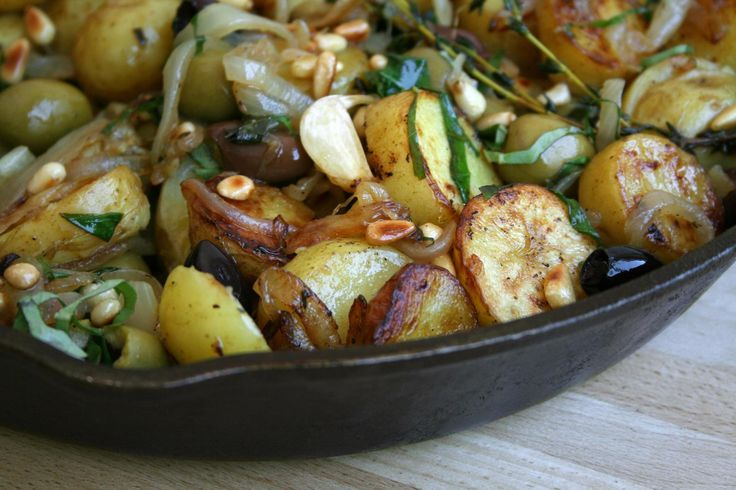 Green and black olives add a new dimension to pan-fried potatoes.