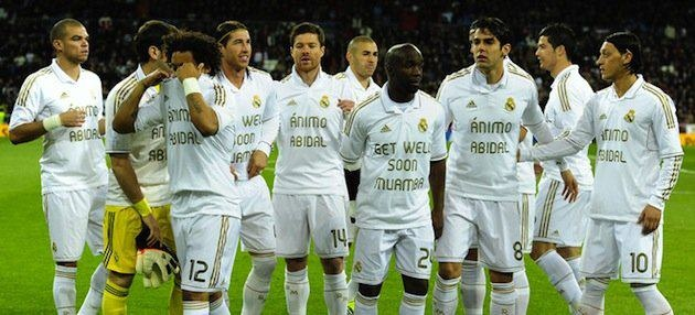 Football is about brotherhood     Real Madrid wear shirts on one side supporting Barcelona's Eric Abidal and Fabrice Muamba on the other.