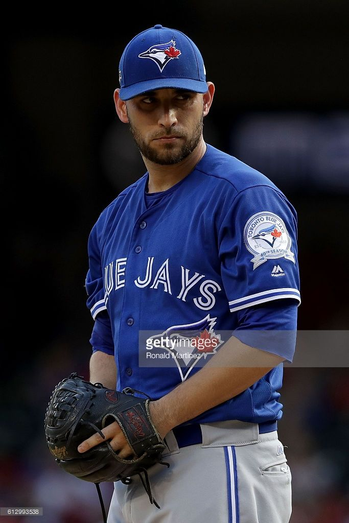 Marco Estrada #25 of the Toronto Blue Jays prepares to throw a pitch against the Texas Rangers during the first inning in game one of the American League Divison Series at Globe Life Park in Arlington on October 6, 2016 in Arlington, Texas.