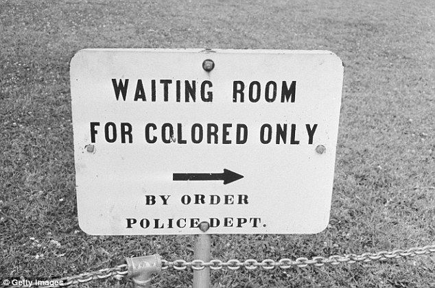 The Supreme Court ended segregation in schools in 1954 while all legally-enforced public segregation was abolished by the Civil Rights Act of 1964 (pictured: a sign in Jackson, Mississippi which reads 'Waiting Room For Colored Only)