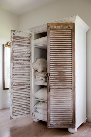 Create an armoire– Add crown moulding, bun feet and 2 shutters to a bookcase