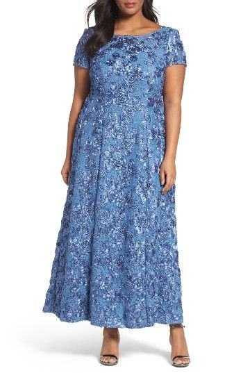 Rosette Lace Short Sleeve A-Line Gown (PlusSize) at Nordstrom.com. Satin rosettes sprinkled with sequin shimmer are scattered over a sophisticated lace gown in a strikingblue shade. The fitted A-line style twirls with your every move.