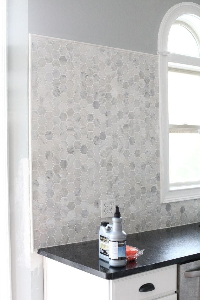 DIY tutorial on backsplash tiling. I like the granite hexagons!: