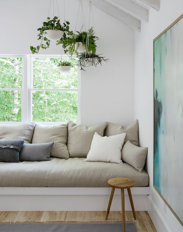 Scandinavian Beach House Chic Is Our New Favorite Look Hunker In 2020 Built In Sofa House Interior Home Interior Design