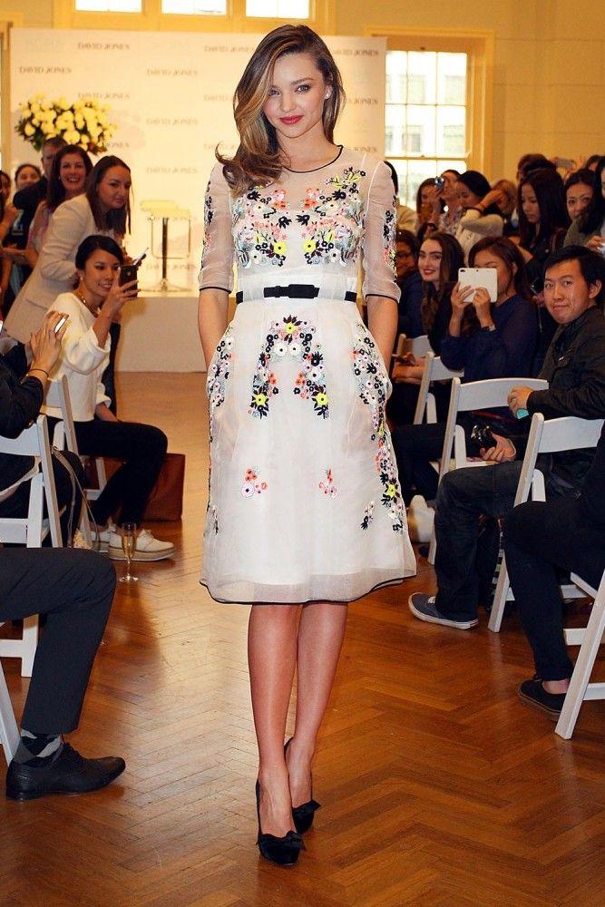 Miranda Kerr in a feminine Erdem dress with spring flower embroidery.
