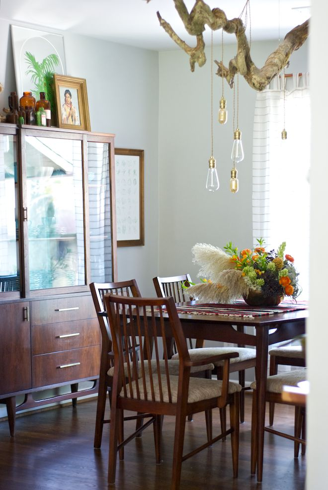 Bri and Trey Denton's mid-century dining room furniture was passed down to them from grandparents. Learn more about their unique style story on the blog.