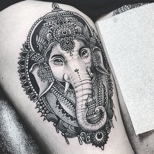 9. Alluring animal icon on the thigh This black thigh ink shows a majestic elephant, adorned with a traditional Indian decoration. If you see this tattoo – be sure that the owner is balanced and wise.