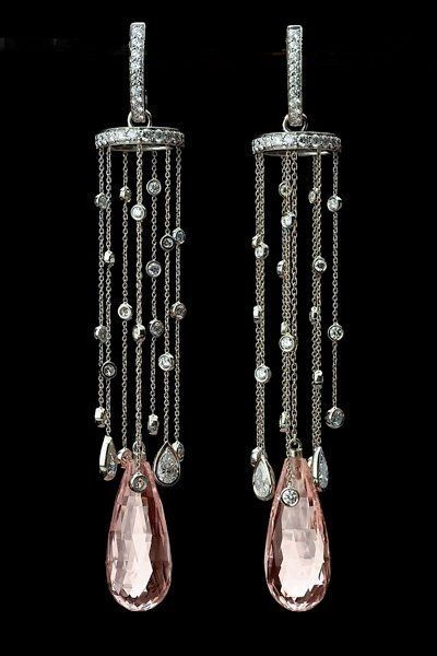 Morganite and diamond earrings. They look like rain falling down! If anyone knows who the designer or jeweler is, please leave a comment.