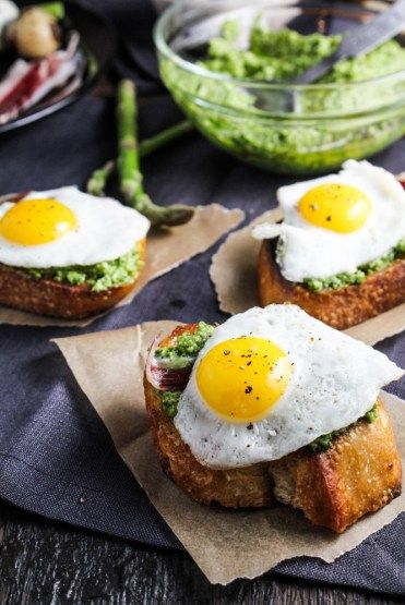 Duck Fat Toasts with Quail Eggs and Asparagus Pesto - a great Easter appetizer {Katie at the Kitchen Door}