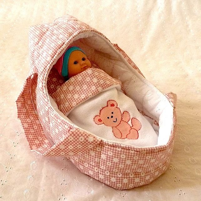 Small Pink  Doll's Carrycot with Free Doll £12.99