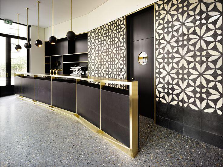 """KARAK designer tiles. VeSta, """"weiß"""" glazing with Raku firing. Bistrot Salon, Zurich, Switzerland. Loeliger Strub Architektur."""