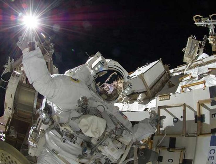 "Astronaut ""touching"" the sun. Image credit: NASA"