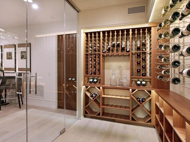A Large, Humidified Wine Room Lines The Back Wall Of This Basement Space  That Begs To Entertain ~ The Custom Shelving Maximizes Storage Space, ...