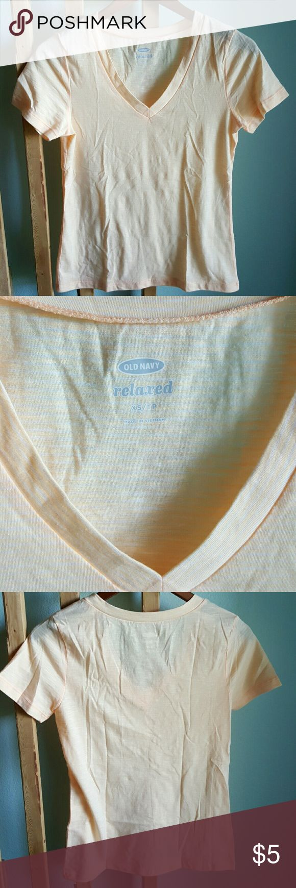 Old Navy Relaxed Tee NWOT Super comfy, relaxed tee from Old Navy! Never been worn and no flaws. Just trying to make room in my dresser.   The color isn't depicted well in the pictures, but it's more of a light peach color than yellow or orange. Old Navy Tops Tees - Short Sleeve
