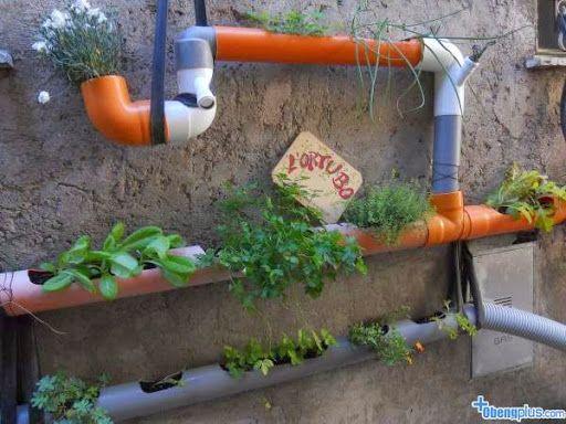 Backyard vertical garden design with pipe  | http://backyard-designs-ideas.blogspot.com/2014/03/designing-backyard-with-unused-junk.html
