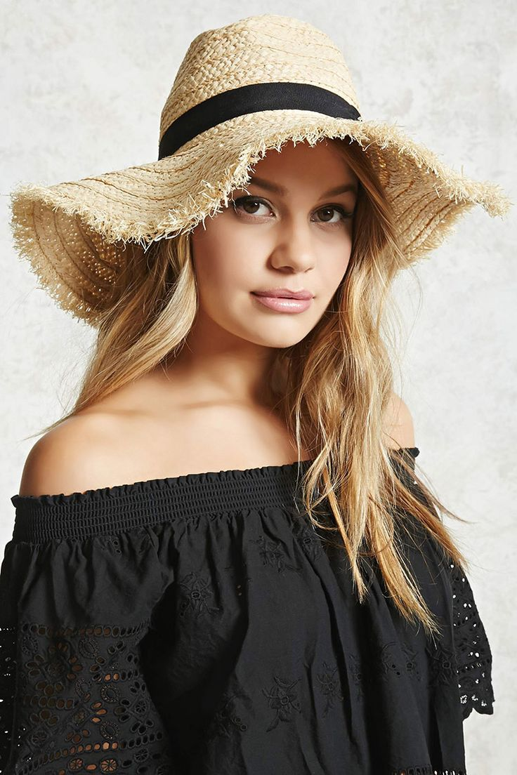 A braided straw fedora featuring a wide floppy brim, fringe trim, a contrast band, and a pinched crown.