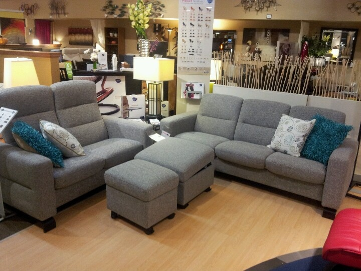 Stressless Wave In Grey Fabric Highback Loveseat And Lowback Sofa Shown  With Large And Medium Modern Ottomans Now On Floor At Forma Furniture As Of