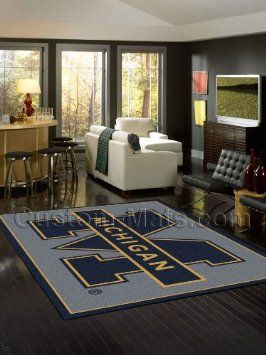 "Amazon.com: Michigan Wolverines 5' 4"" x 7' 8"" Team Spirit Area Rug: Home & Kitchen"